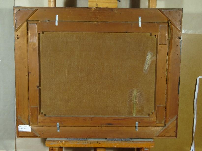 På bagsiden kan man se de gamle reparationer på maleriet